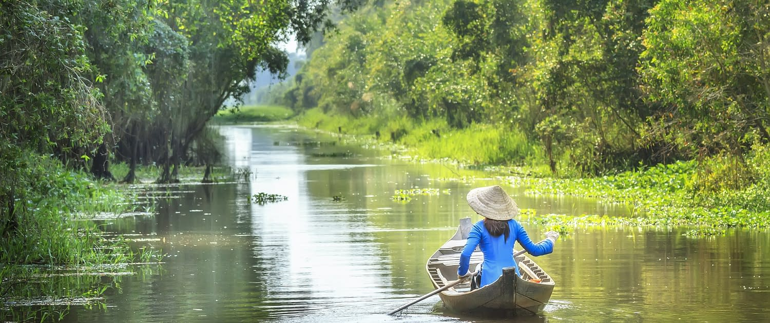 Woman rowing on the river in Vietnam